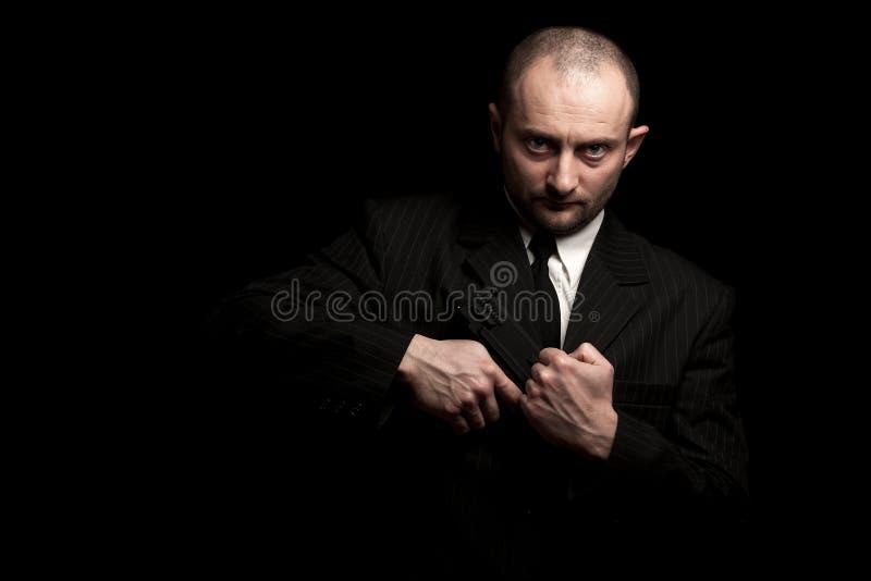 Pizca del hombre su arma imagen de archivo libre de regalías