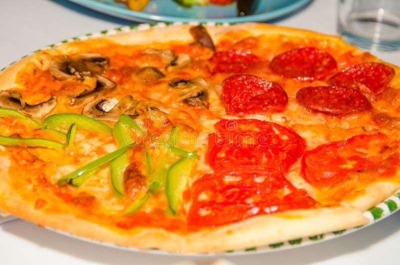 Pizza 4 in 1 fotografia stock libera da diritti