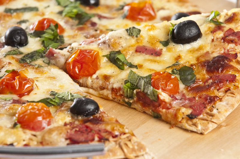 Pizza. Baked pizza served on wooden board royalty free stock photography