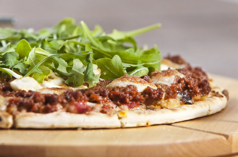 Pizza. Baked pizza served on wooden board stock photos