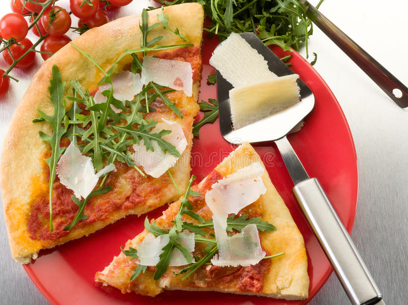Pizza with arugula and parmesan