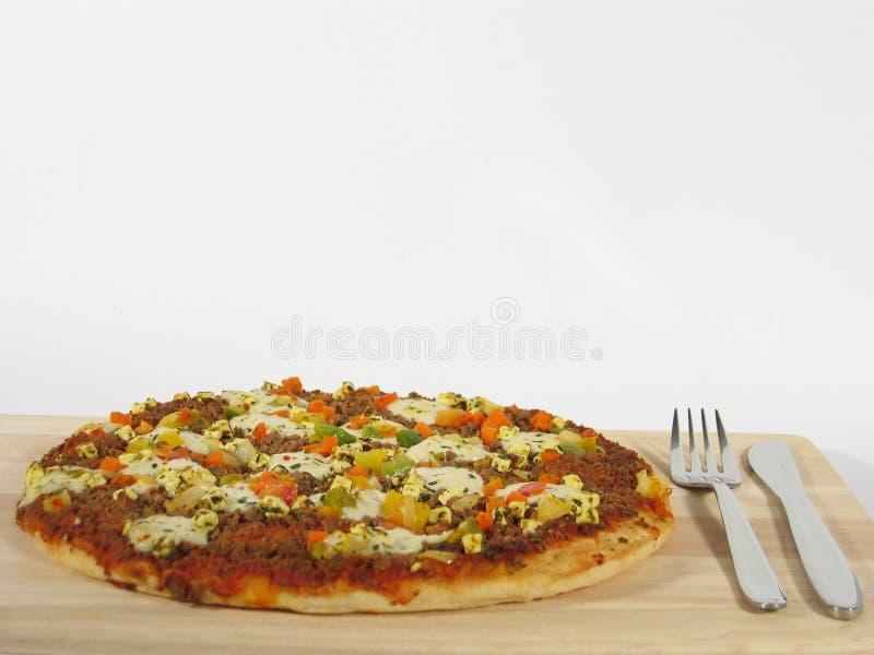 Pizza avec des couverts photo stock