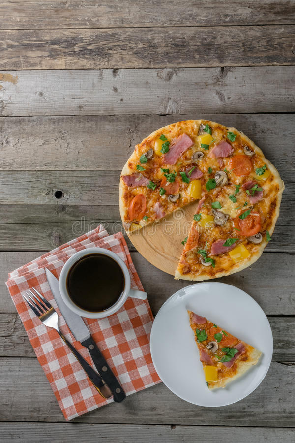 Pizza with Bacon on Breakfast. My breakfast - pizza with bacon on wooden boards: food background royalty free stock photo