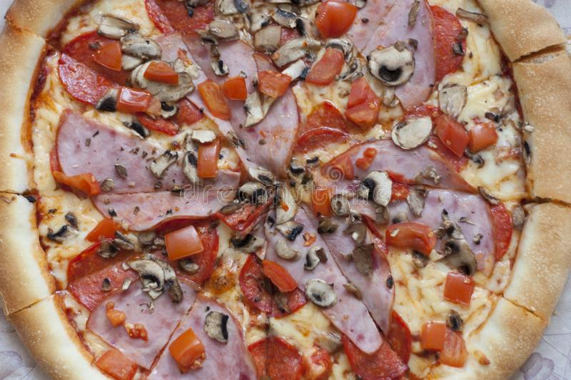 Pizza with bacon ham and sausage on wooden table, Top view photo stock photos