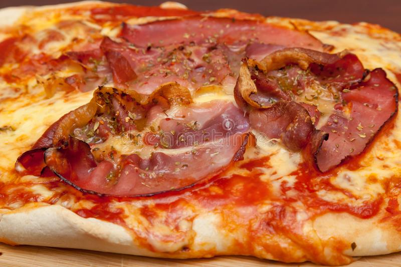 Pizza with bacon. Shot of pizza with bacon royalty free stock image