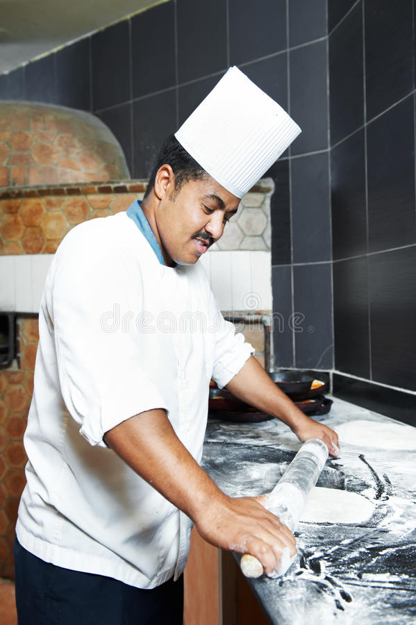 Pizza baker juggling with dough royalty free stock images