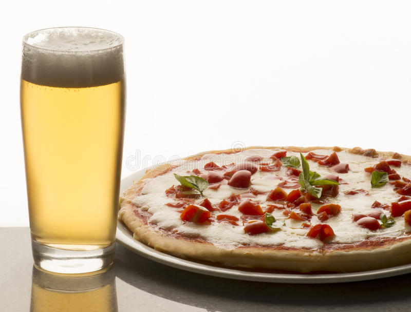 Pizza and beer royalty free stock photos