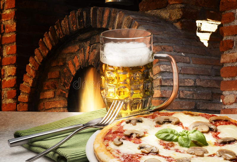 Pizza and beer royalty free stock images