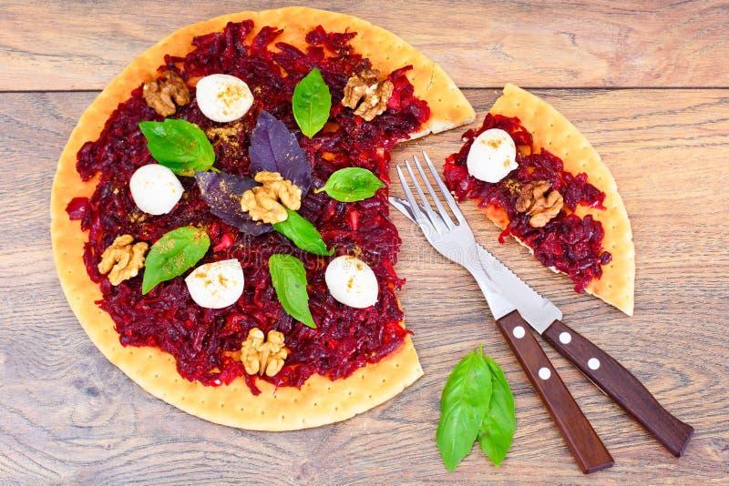 Pizza with Beet, Nut, Cheese, Mozzarella and Basil. Studio Photo stock photo