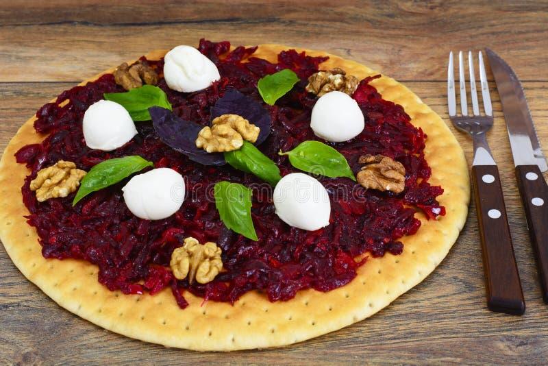 Pizza with Beet, Nut, Cheese, Mozzarella and Basil. Studio Photo royalty free stock photo