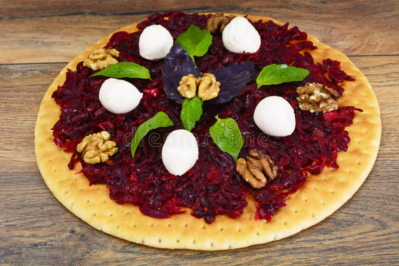 Pizza with Beet, Nut, Cheese, Mozzarella and Basil. Studio Photo royalty free stock photography