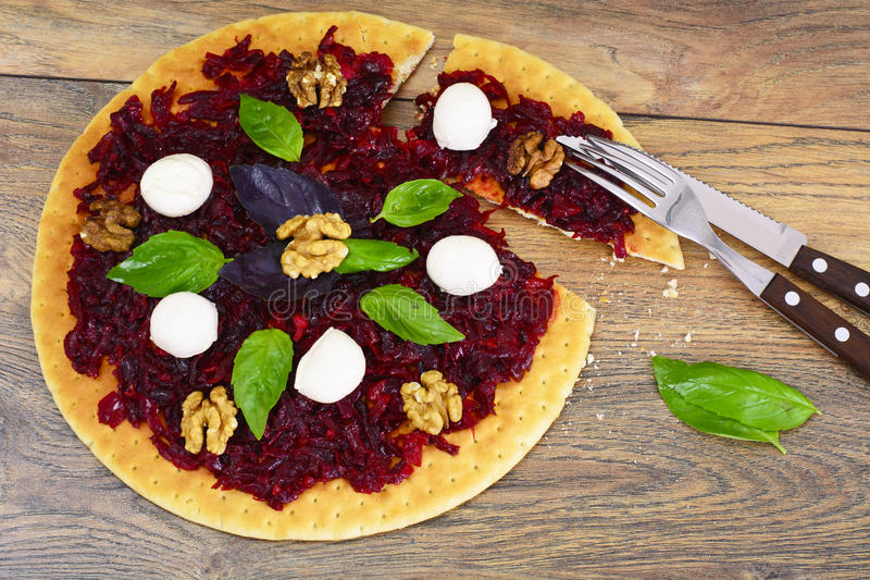 Pizza with Beet, Nut, Cheese, Mozzarella and Basil. Studio Photo royalty free stock image