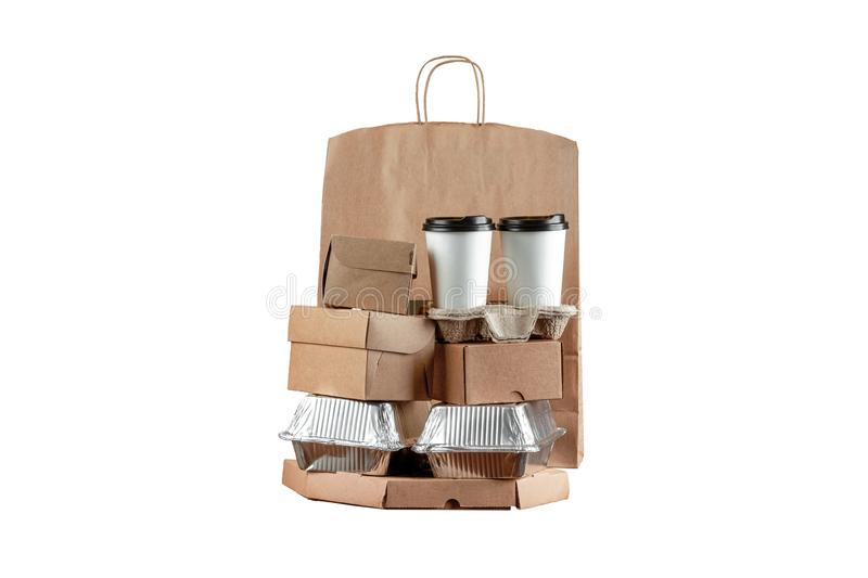 Pizza boxes and food delivery paper bag with a disposable cup of coffee and a wok box on a white background. Home delivery of royalty free stock image