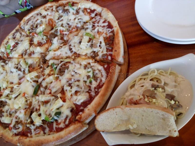 pizza and carbonara royalty free stock image
