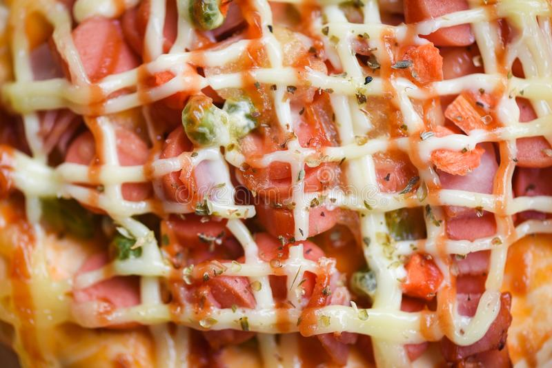 Pizza cheese sauce close up top view / pizza topping sausages hot dog ketchup and spices dood and tasty stock photos