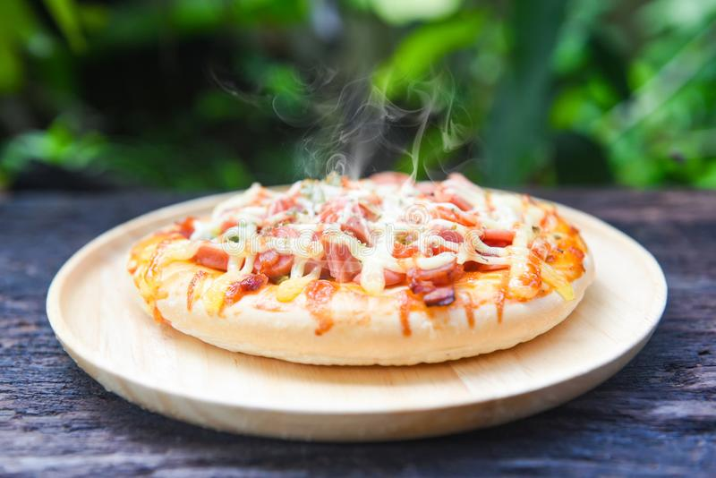 Pizza cheese sauce top view on rustic wood background - pizza topping sausages hot dog ketchup and spices food and tasty concept royalty free stock photos