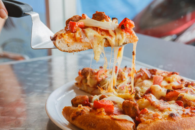 Pizza. With chicken, pork tomato and pineapple stock images