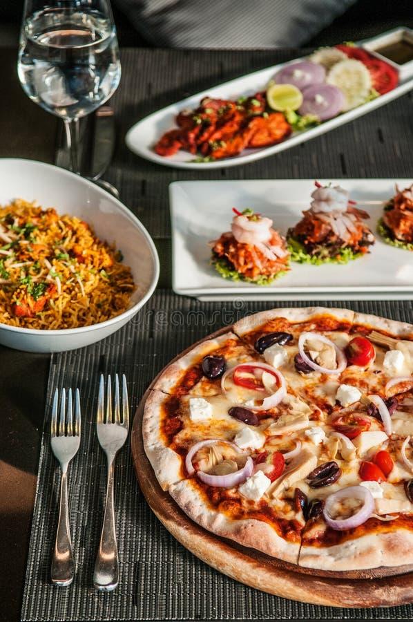 Pizza, Chicken Tandoori, Chicken briyani, Indian and Italian famous cuisine royalty free stock photos
