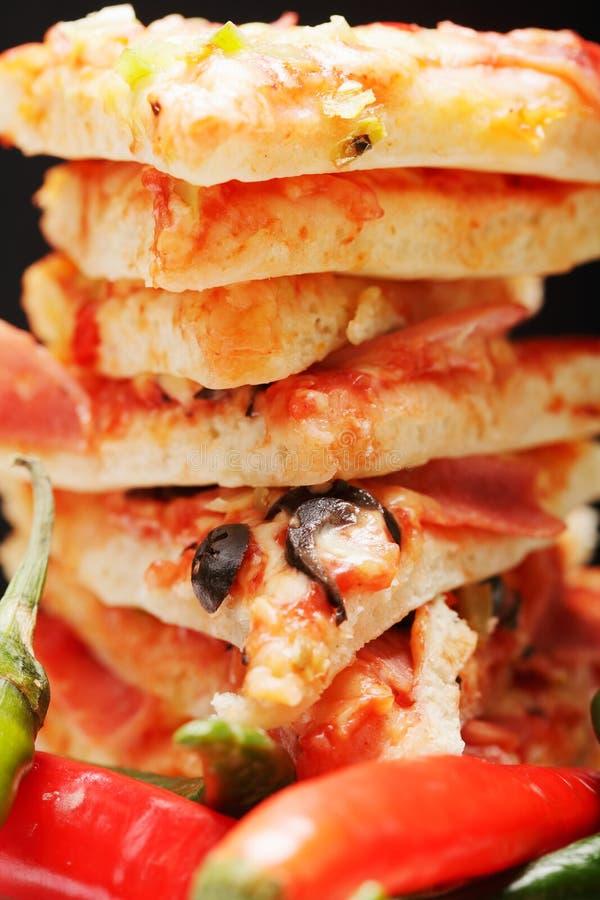 Pizza and chili closeup stock photos