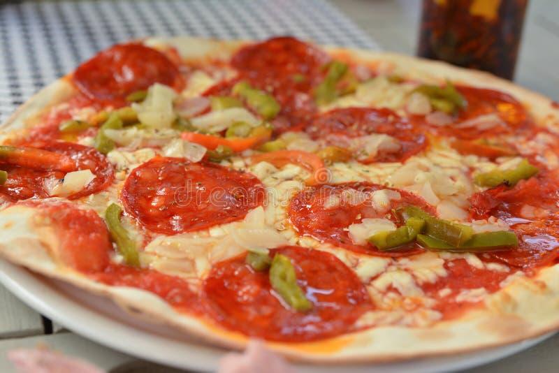 Pizza with chorizo salami Sharp sausages stock image
