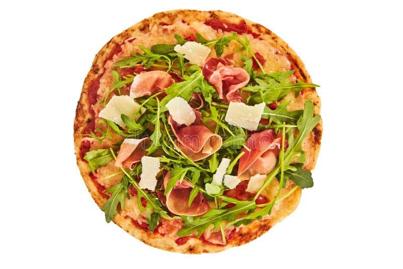 Pizza cocida horno entero del prosciutto y del cohete fotografía de archivo