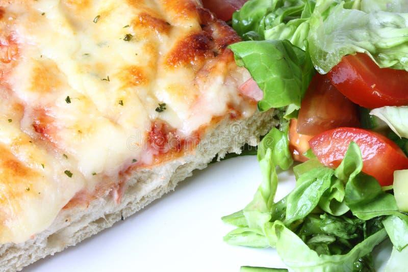 Pizza com salada. foto de stock royalty free