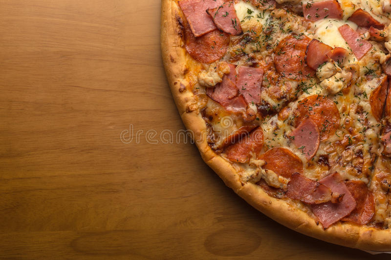 Pizza, composition: sauce, mozzarella cheese, pepperoni sausage, ham, bacon stock image