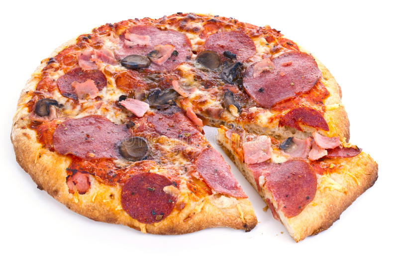 Pizza con la rebanada fotografía de archivo libre de regalías