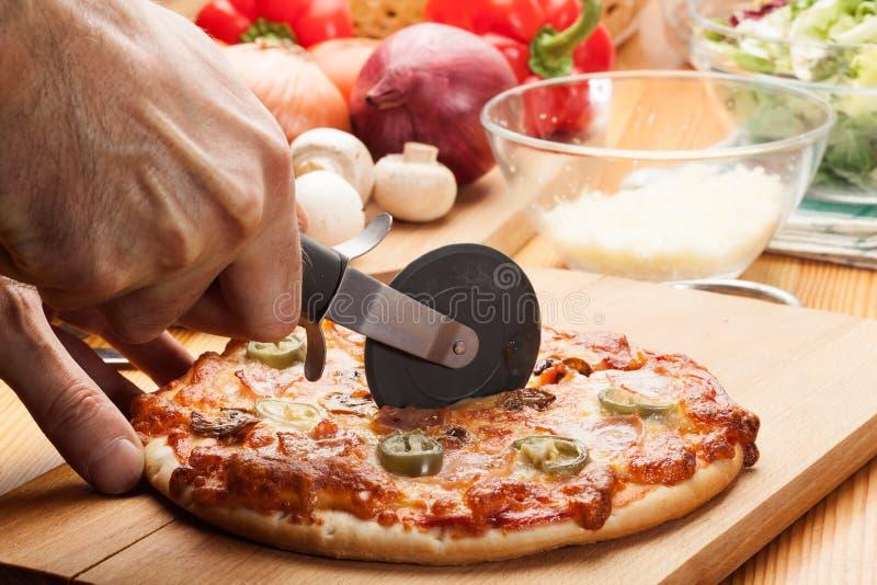 Pizza con queso fotos de archivo