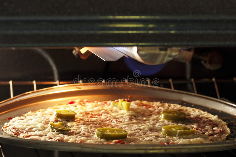 Download Pizza Cooking in the Oven stock photo. Image of oven - 25896278