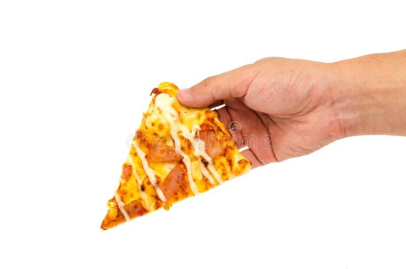 pizza da posse da mão do homem foto de stock