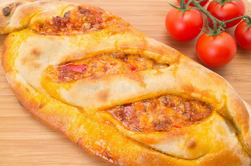 Pizza de Calzone imagen de archivo libre de regalías