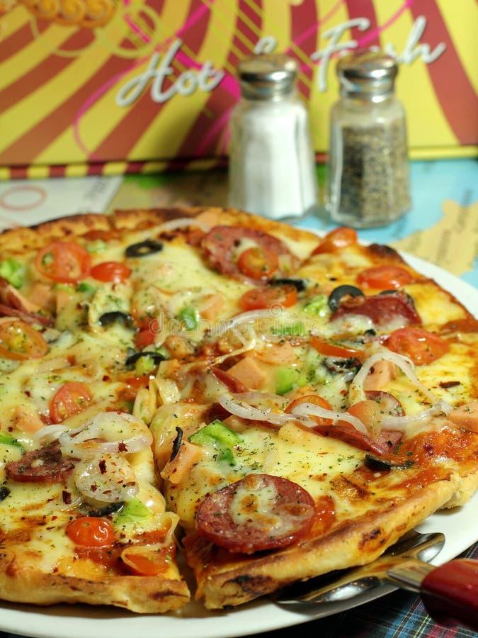 Pizza de fromage de pepperoni images libres de droits