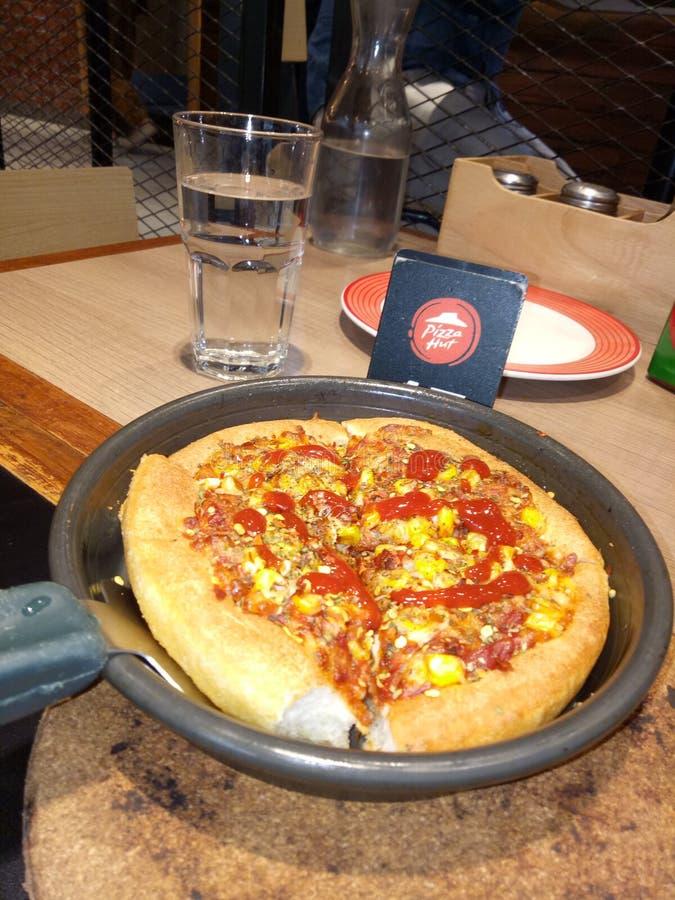 Pizza de Pizza Hut del indio fotografía de archivo