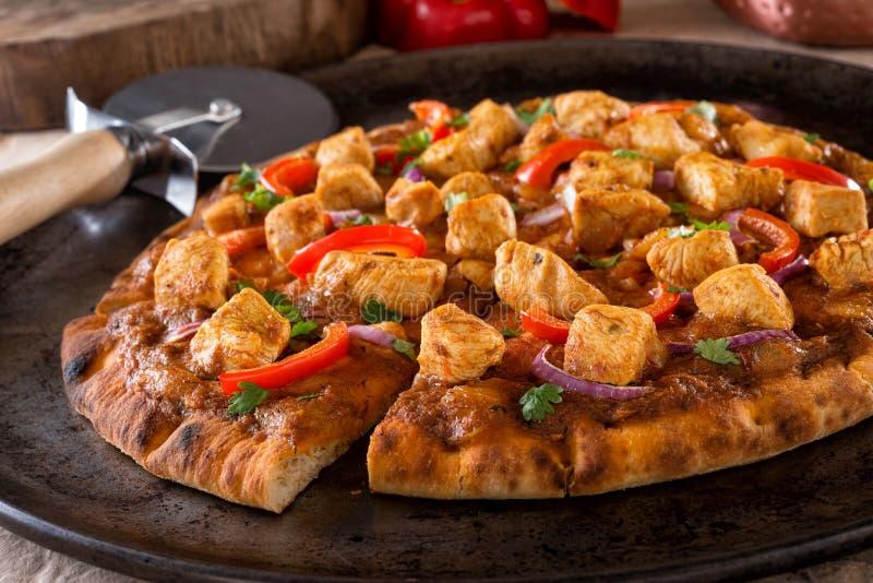 Pizza del pollo de la mantequilla fotos de archivo