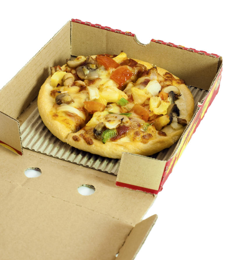 Pizza delivery. Fresh vegetarian pizza delivery in box royalty free stock photography