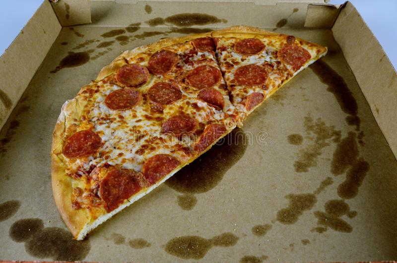 Pizza in a delivery box. Half of pepperoni Pizza in a delivery box stock photography