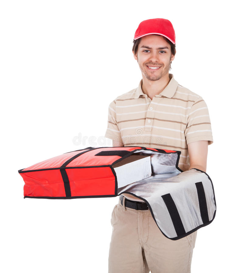 Pizza delivery boy with thermal bag. Isolated on white royalty free stock images