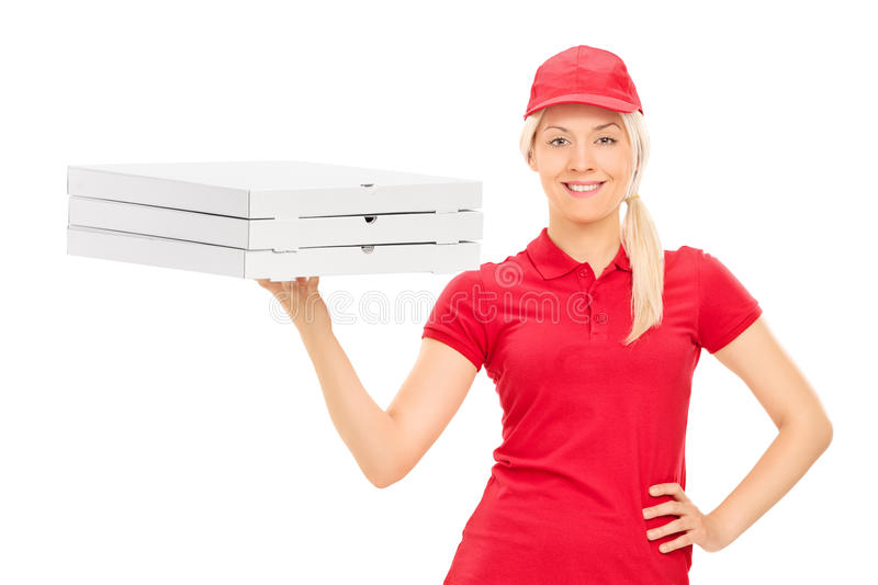 Pizza delivery girl holding boxes. Isolated on white background royalty free stock image