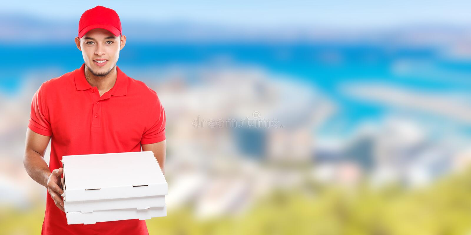 Pizza delivery latin man boy order delivering job deliver box young banner copyspace copy space. Outdoors stock image