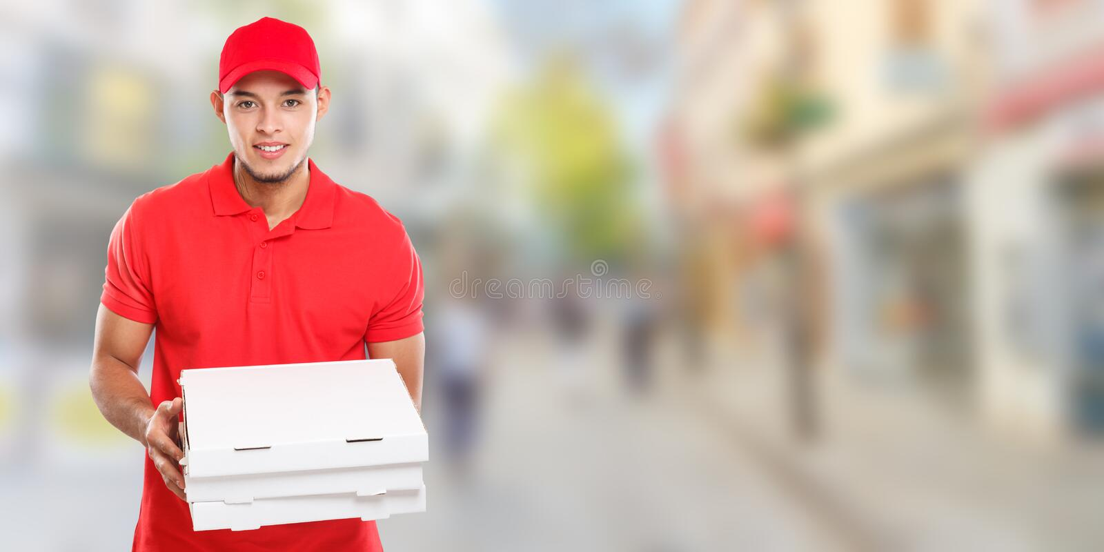 Pizza delivery latin man boy order delivering job deliver box young town banner copyspace copy space. City royalty free stock photo