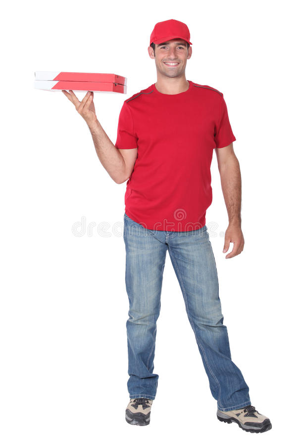 Pizza delivery man. Holding cardboard pizza box royalty free stock photos