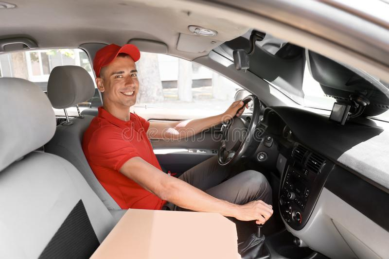 Pizza delivery man driving a car royalty free stock photo