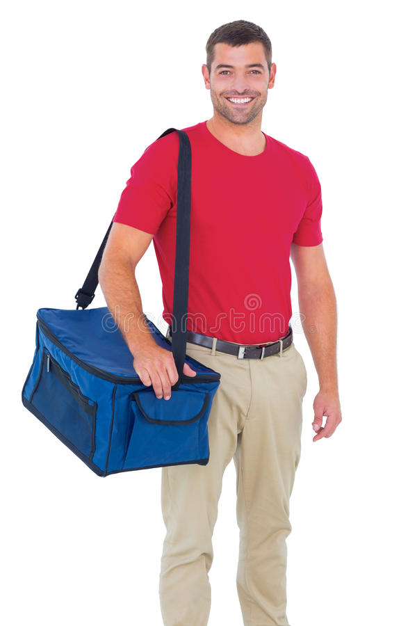 Pizza delivery man holding bag. Portrait of pizza delivery man holding bag on white background royalty free stock photography