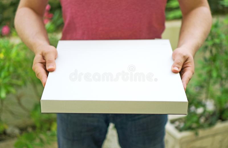 Pizza delivery man. Pizza delivery man holding pizza box. Space for your text stock images