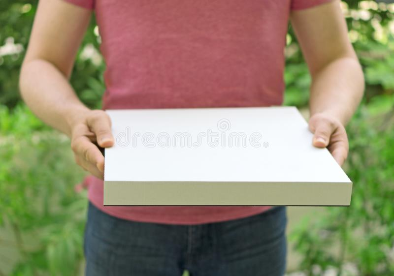 Pizza delivery man. Pizza delivery man holding pizza box. Space for your text royalty free stock photography