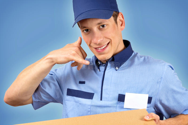 Pizza delivery man. Isolated on blue background royalty free stock image