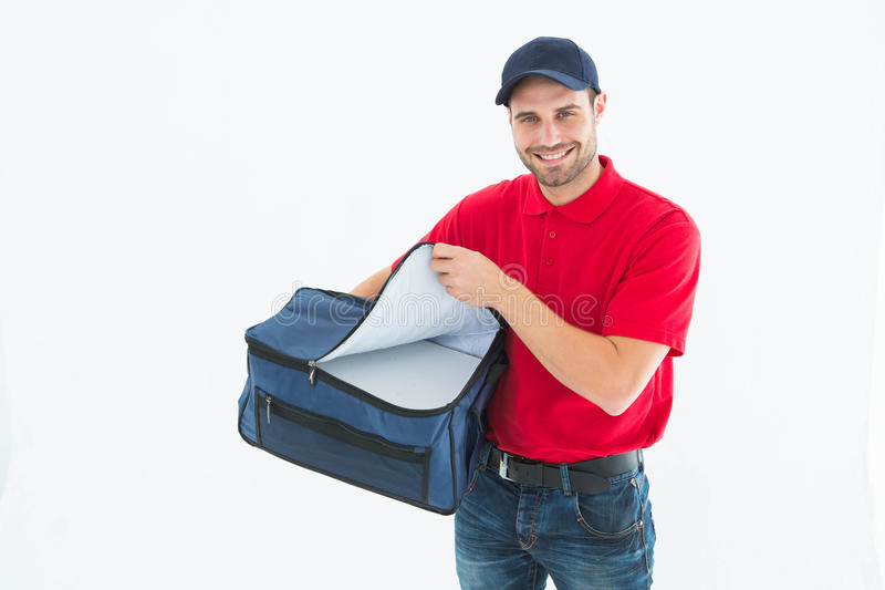 Pizza delivery man opening bag. Portrait of pizza delivery man opening bag on white background stock image