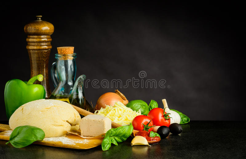Pizza Dough with Ingredients and Copy Space royalty free stock image