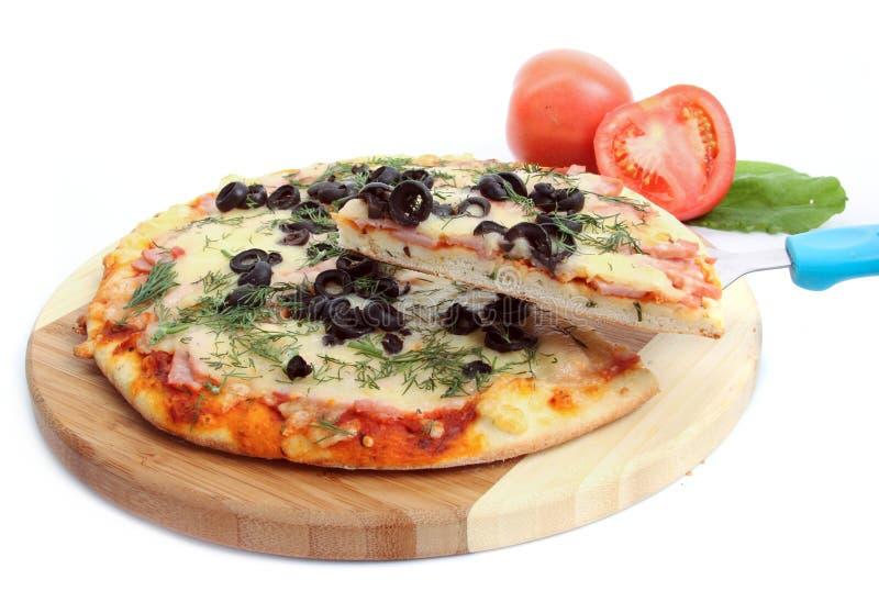 Pizza en blanco imagen de archivo
